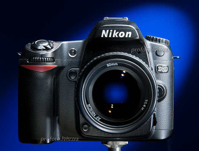 camera for shooting nikon d80 items on a blue background