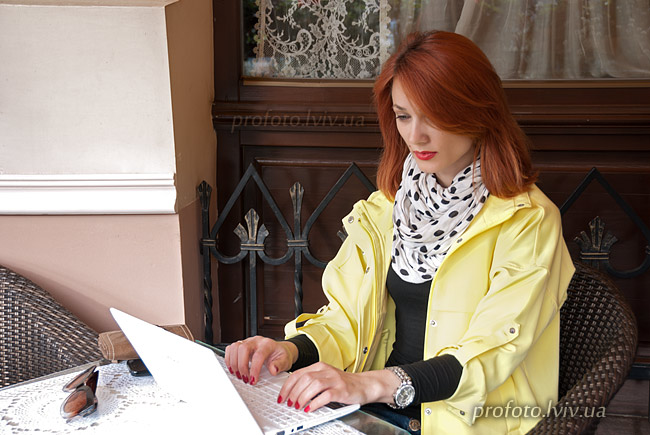 Girl working on a laptop while sitting at the table